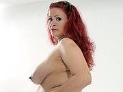 Pregnant lady with a rose in white lingerie stripping